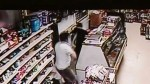Surveillance video of convenience store clerk confronts robber with a sword